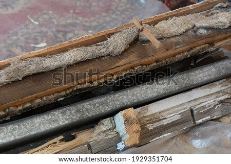 Construction garbage. Dismantled old window and sill. Royalty-Free Stock Photo #1929351704