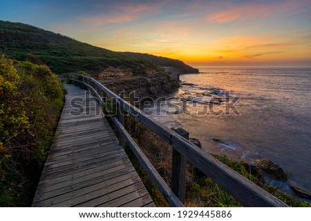 Golden hour sunrise at Putty Beach NSW Australia, situated in the Bouddi National Park Royalty-Free Stock Photo #1929445886