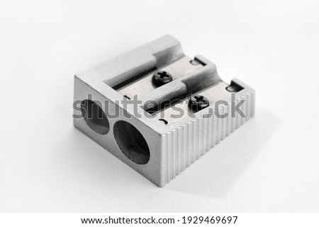 Metallic pencil sharpener with Double Hole isolated on white background Royalty-Free Stock Photo #1929469697