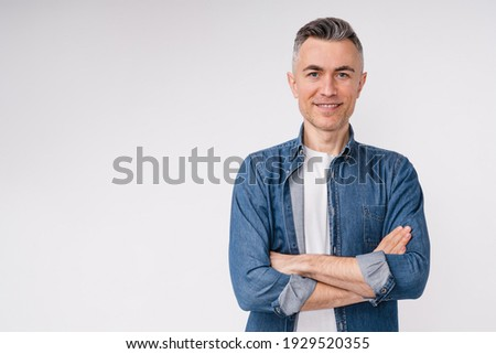 Confident caucasian middle-aged man in casual clothes with his arms crossed isolated over white background Royalty-Free Stock Photo #1929520355