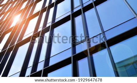 Fragment of glass and metal facade walls. Commercial office buildings. Abstract modern business architecture. Royalty-Free Stock Photo #1929647678