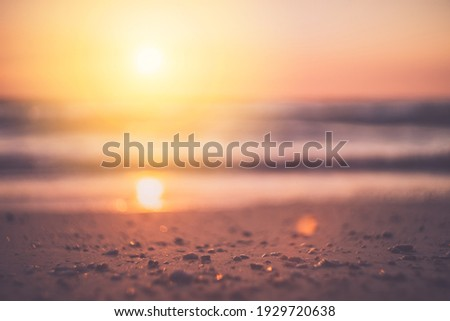 Tropical beach with smooth wave and sunset sky abstract background. Copy space of business summer vacation and travel adventure concept. Vintage tone filter effect color style. Royalty-Free Stock Photo #1929720638