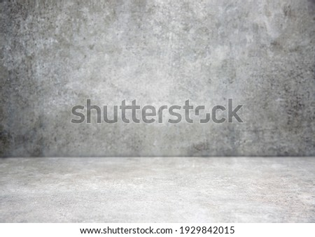 Grey stone grungy stage,empty room background,free space interior.Cement wall.Advertisement design studio.Modern backdrop. Royalty-Free Stock Photo #1929842015