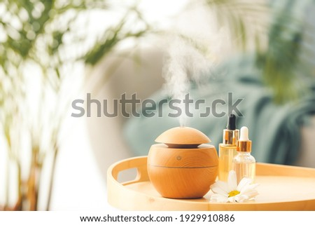 Aroma oil diffuser on table in room Royalty-Free Stock Photo #1929910886