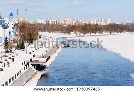 Sozh river embankment in winter. Ice drift. Early spring in Gomel. Gomel palace and park ensemble. View of the embankment from the pedestrian bridge over the Sozh River. Gomel. Belarus Royalty-Free Stock Photo #1930097465
