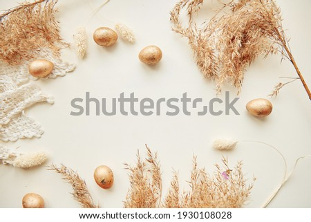 Happy Easter concept. Beige minimalism background with cope space, top view banner