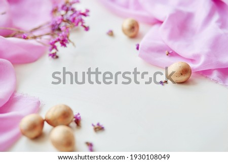Easter poster and banner template with Easter eggs on light pink background. Greetings and presents for Easter Day in flat lay styling. Delicate pink banner