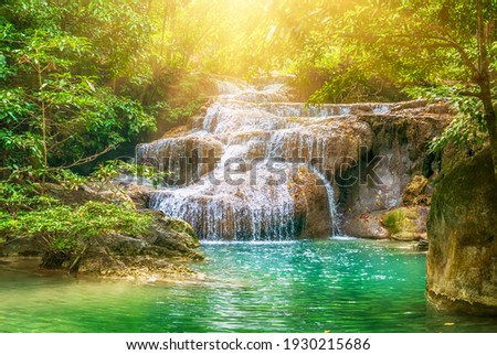 Forest and waterfall at Ton Nga Chang Waterfall, Songkhla, Thailand. Tourustic attraction and famous sightseeng, natural outdoor jungles landscape Royalty-Free Stock Photo #1930215686