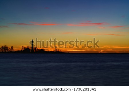 Beautiful nightly seascape with lighthouse and moody sky at the sunset. Royalty-Free Stock Photo #1930281341