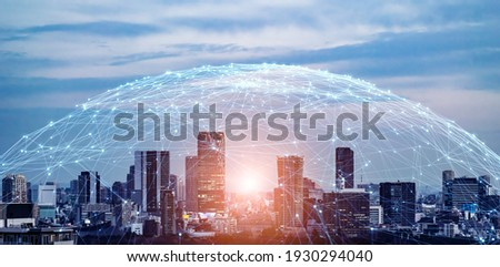 Modern cityscape and communication network concept. Telecommunication. IoT (Internet of Things). ICT (Information communication Technology). 5G. Smart city. Digital transformation. Royalty-Free Stock Photo #1930294040