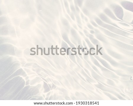 Closeup blur abstract of surface blue water. Abstract of surface blue water reflected with sunlight for background.Top view of blue water. Water splashed use for graphic design Royalty-Free Stock Photo #1930318541