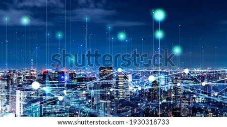 Modern cityscape and communication network concept. Telecommunication. IoT (Internet of Things). ICT (Information communication Technology). 5G. Smart city. Digital transformation. Royalty-Free Stock Photo #1930318733