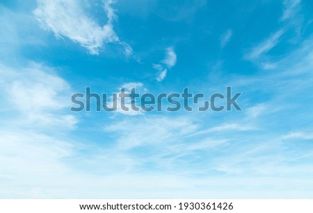 Summer Blue Sky and white clouds background. Beautiful clear cloudy in sunlight spring season. Panoramic vivid cyan cloudscape in nature environment. Outdoor horizon skyline with spring sunshine.  Royalty-Free Stock Photo #1930361426