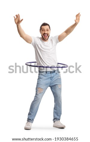 Full length portrait of a happy young man playing with a hula hoop isolated on white background Royalty-Free Stock Photo #1930384655