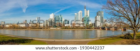 Panoramic picture from Main river bank over Frankfurt skyline with blue sky and sunshine in winter