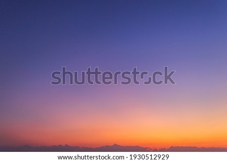 Colorful sunset sky in the evening on twilight, dusk sky background  Royalty-Free Stock Photo #1930512929