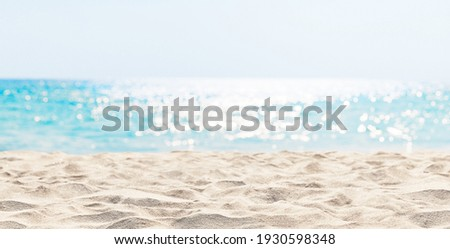 Panorama of a beautiful white sand beach and turquoise water in Maldives. Holiday summer beach background.. Wave of the sea on the sand beach. Royalty-Free Stock Photo #1930598348