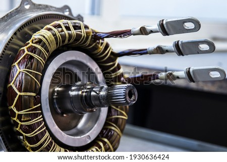 Partially disassembled for repair IPM-SynRM (Internal Permanent Magnet Synchronous Reluctance Motor) motor of an moder electric vehicle. EV maintenance, service; repair concept; Royalty-Free Stock Photo #1930636424