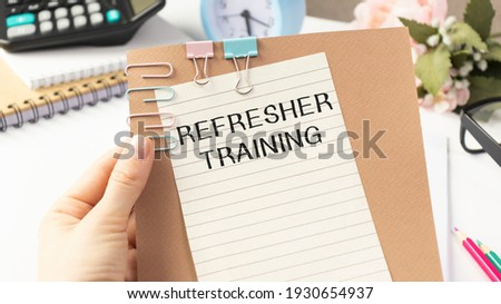 Refresher Training text on paper in hand. Royalty-Free Stock Photo #1930654937