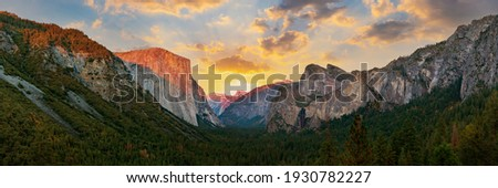 Yosemite valley nation park during sunset view from tunnel view on twilight time. Yosemite nation park, California, USA. Panoramic image. Royalty-Free Stock Photo #1930782227