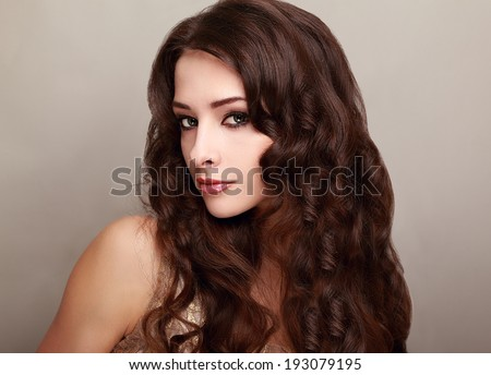 Beautiful woman with long curly hair looking happy #193079195