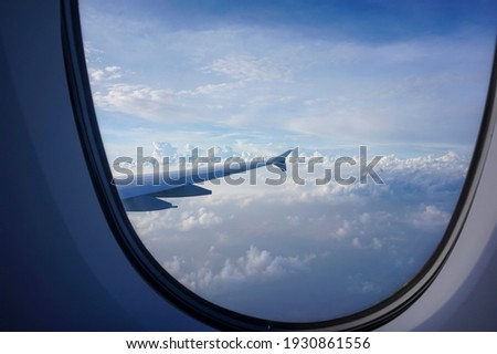 The blue, clear sky and beautiful clouds with the wings of the airplane that can see outside the window. High resolution photo editing source bookcover design for synthetic sources