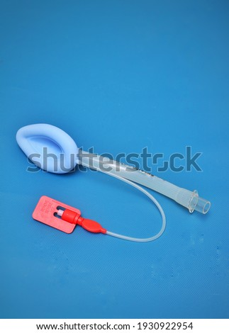 An adult laryngeal mask airway (LMA).It is a medical device that keeps a patient's airway open during anaesthesia or unconsciousness. It is a type of supraglottic airway device Royalty-Free Stock Photo #1930922954