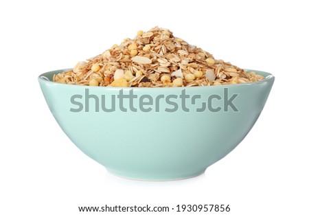 Bowl with fresh muesli on white background Royalty-Free Stock Photo #1930957856