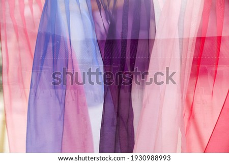 Colorful transparent Korean traditional clothes are being dried on a clothesline at Namsan Hanok Village near Seoul, South Korea   Royalty-Free Stock Photo #1930988993