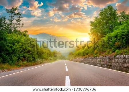Landscape with the image of mountain road in montenegro Royalty-Free Stock Photo #1930996736