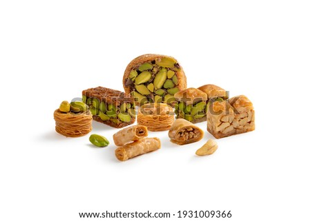 Oriental nice Mixed Baklava sweets isolated on a white background Royalty-Free Stock Photo #1931009366