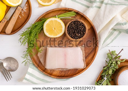 Seafood recipe. Wild caught halibut with lemon and dill.