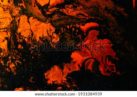 Fluid art texture. Abstract background with mixing paint effect. Liquid acrylic picture with artistic mixed paints. Can be used for wallpaper. Trendy colors of 2021 year - orange, black