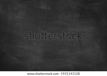 Chalk rubbed out on blackboard background Royalty-Free Stock Photo #1931141528