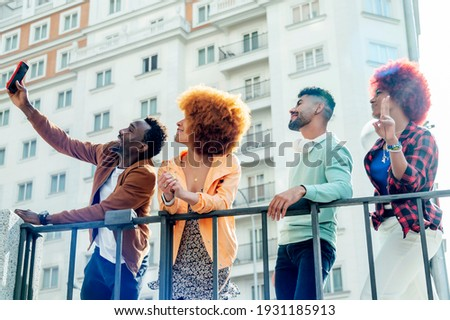 Several modern young people taking a photo with mobile phone - freestyle concept