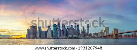 Panoramic view on Manhattan and Brooklyn bridge at sunset, New York City Royalty-Free Stock Photo #1931207948
