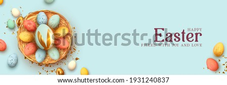 Festive Easter horizontal banner, template header for website. Realistic 3d design elements. Spring holiday. Easter eggs in basket. View from above. Blue background. Vector illustration Royalty-Free Stock Photo #1931240837