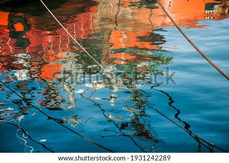 Reflection of fishing boats in the water