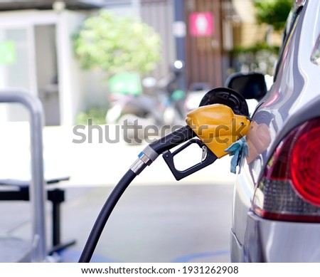 The car is refueling at the gas station. Royalty-Free Stock Photo #1931262908