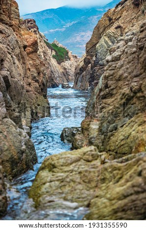 California nature - landscape, beautiful cove with rocks, on the seaside in Garrapata State Park. County Monterey, California, USA. Long exposure photo.