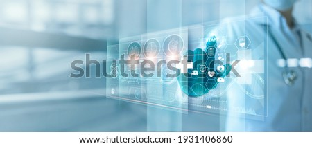 Medicine doctor touching and diagnose electronic medical record of patient on interface. DNA. Digital healthcare and network on modern virtual screen, medical technology and futuristic concept. Royalty-Free Stock Photo #1931406860