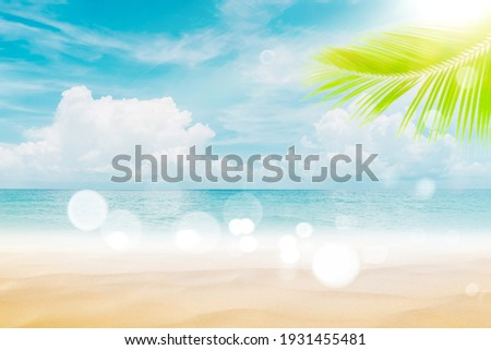Blur beautiful nature green palm leaf on tropical beach with bokeh sun light wave abstract background. Copy space of summer vacation and business travel concept. Vintage tone filter effect color style Royalty-Free Stock Photo #1931455481