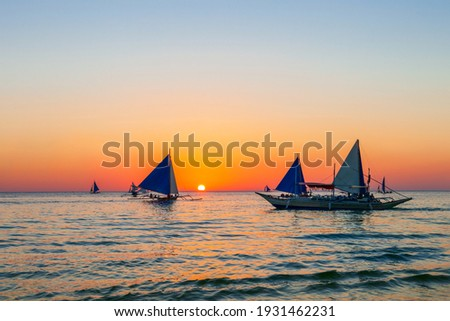 Traditional filipino boat at the idyllic white sand beach at Boracay island in Philiphines Royalty-Free Stock Photo #1931462231