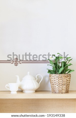 Interior home decoration Tea pot cup and green plant with wall background,  #193149338