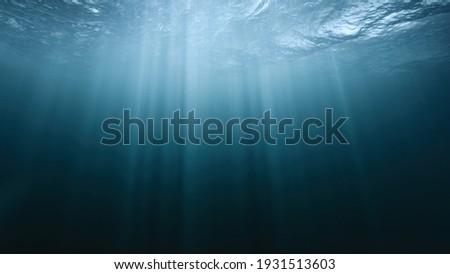 Underwater Light Rays In Dark Stormy Ocean Sea River Abyss Background Darkness Exploration Unknown Fear Hope Hopelessness Deep Arctic Ocean Environment Protection Cold Clean Water Royalty-Free Stock Photo #1931513603