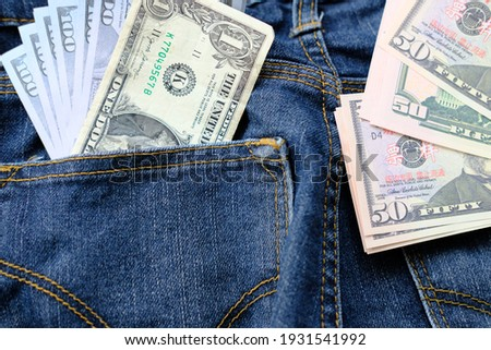 banknote money in pocket jeans and saving money and business growth concept,finance and investment concept