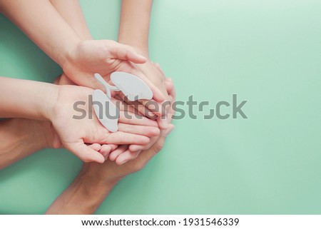 Adult and child hands holding lung, world tuberculosis day, world no tobacco day, lung cancer,  Pulmonary hypertension, Pneumonia, copd, eco air pollution,organ donation, respiratory and chest concept Royalty-Free Stock Photo #1931546339