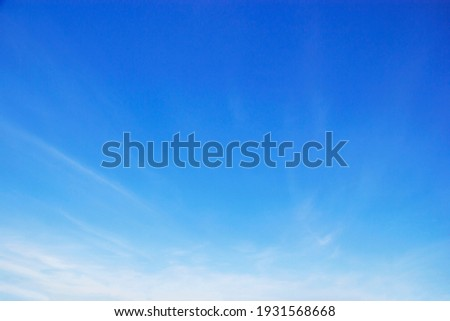 Blue sky background and white clouds soft focus, and copy space horizontal shape Royalty-Free Stock Photo #1931568668