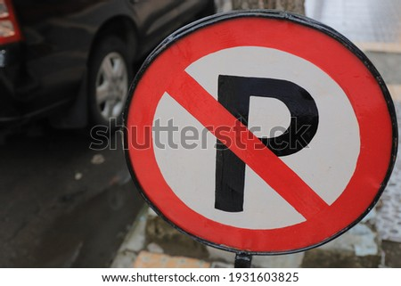 No parking on the street sign. a concept of not obeying parking sign rules