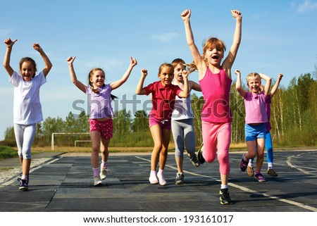 group of children running on the treadmill at the stadium Royalty-Free Stock Photo #193161017